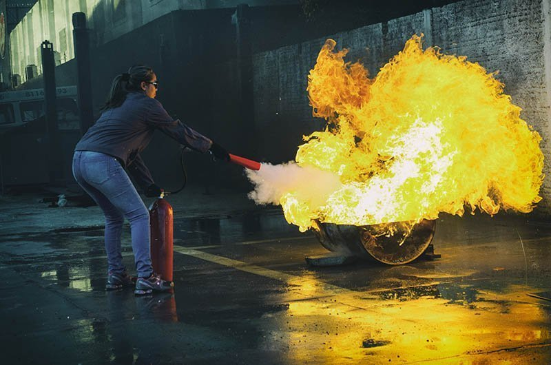 woman fighting a fire