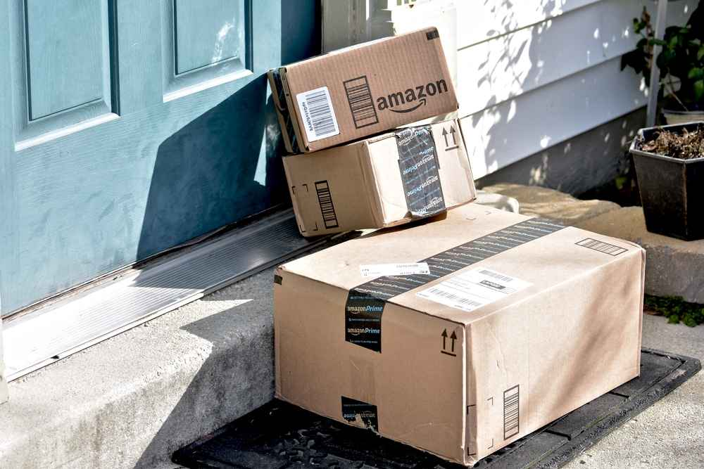 lots of amazon boxes sat on the front porch