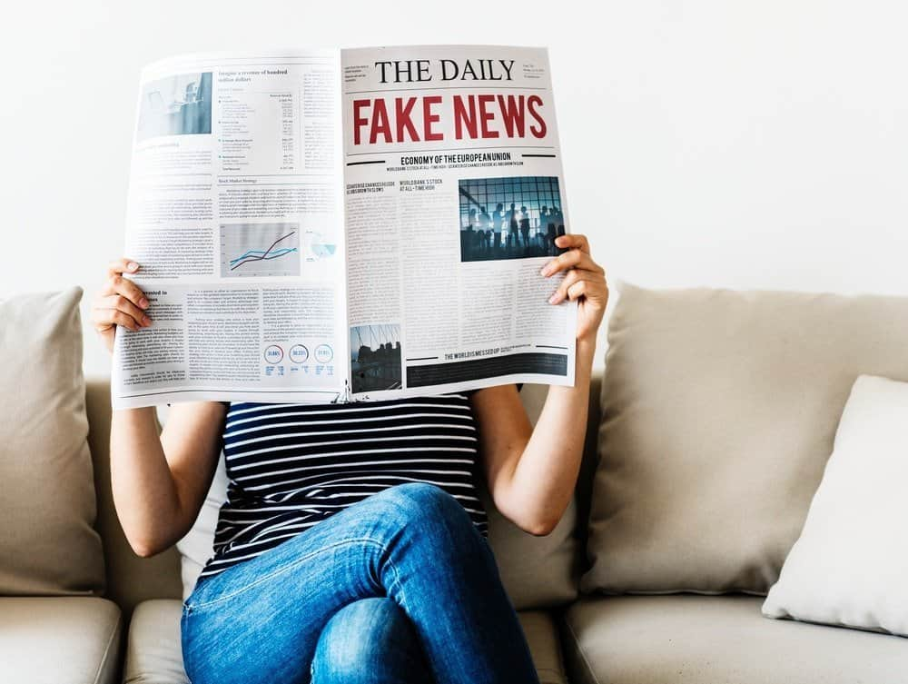 person reading fake news