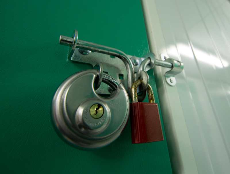 2 padlocks on a latch