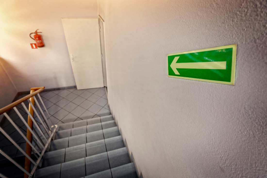 green fire escape arrow pointing down