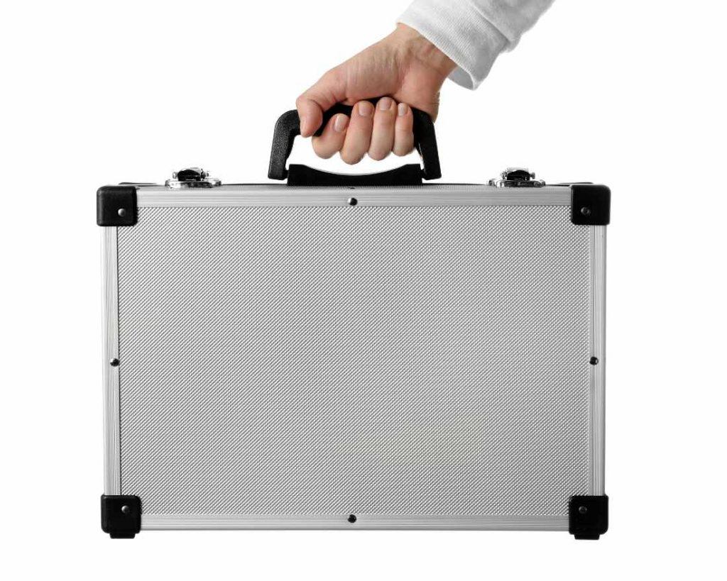 man holding a silver metallic briefcase