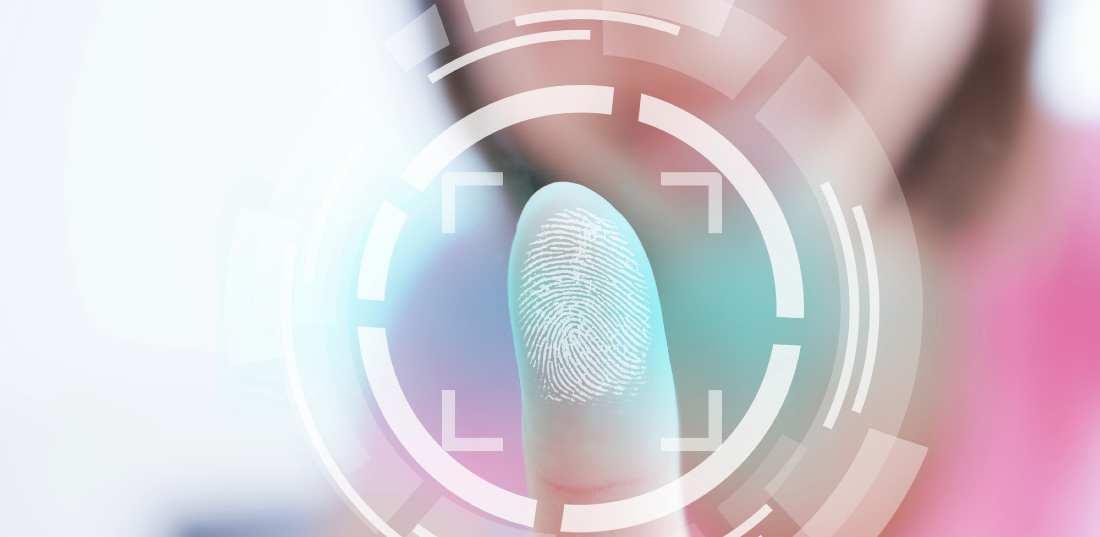 woman scanning her fingerprint on the screen
