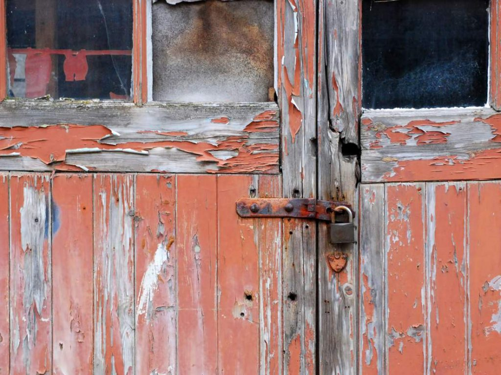 old red garage doors with rusty lock