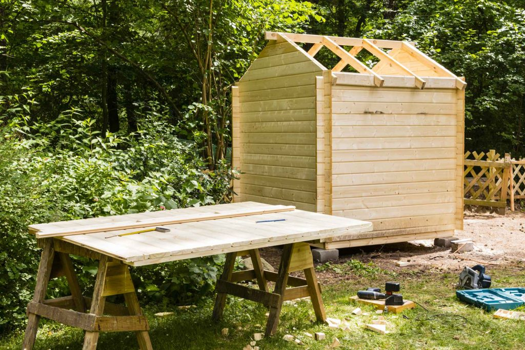 A wooden shed being constructed