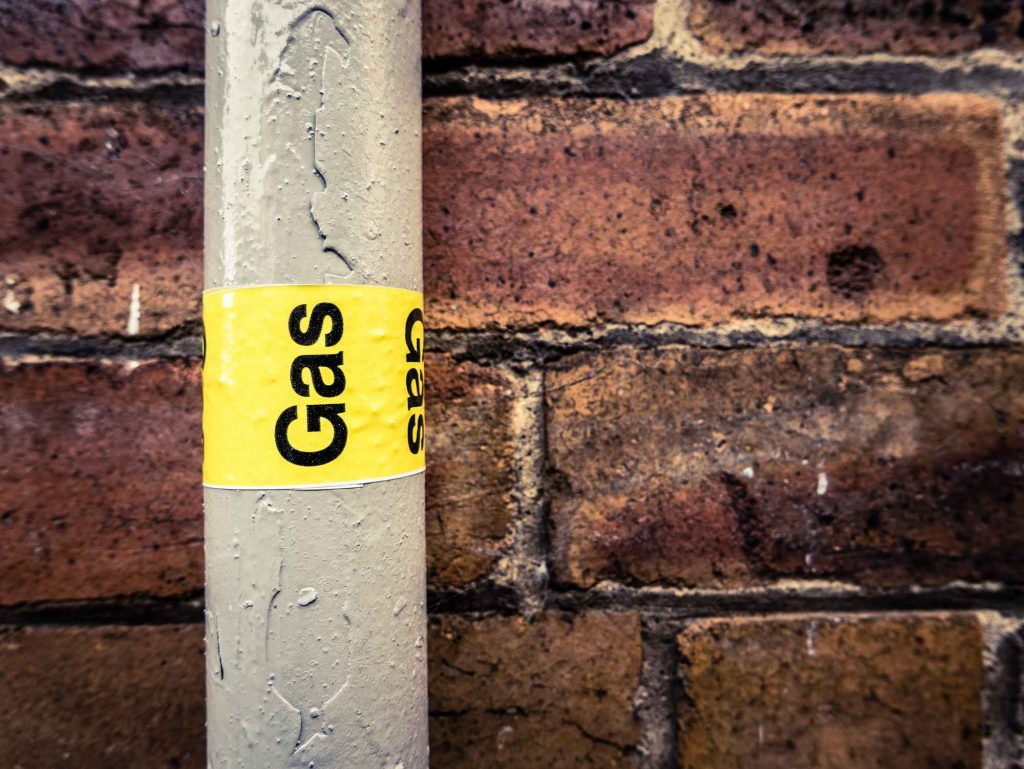 Grey gas pipe with a label on it